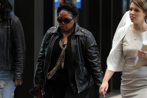 William Balfour's mother, Michele Davis-Balfour, center, heads to the courtroom at the Cook County Criminal Courthouse as the second week of her son's trial begins.