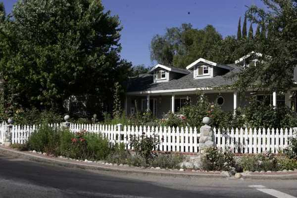 A Thousand Oaks home with a white picket fence. Homeownership is at 15-year lows.