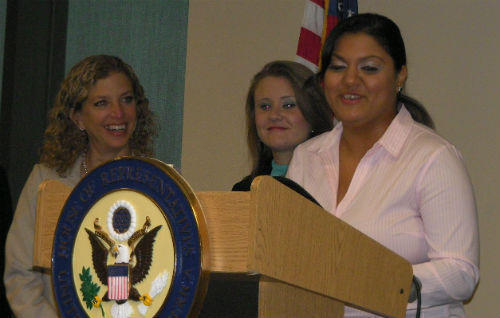 From left: U.S. Rep. Debbie Wasserman Schultz and Broward College students Jessica Marshall and Sahar Naqvi