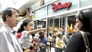 Hundreds of locals waited two hours in line on Sunday to see the grand re-opening of the Glendale Galleria's Disney Store.