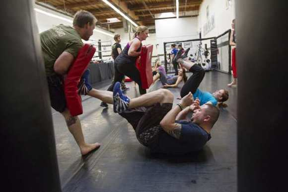 Badir Murad, right, and Michael Burmaster go through drills during a street survival self-defense class at the Fitness Compound in Huntington Beach on Thursday, April 26. (Scott Smeltzer)