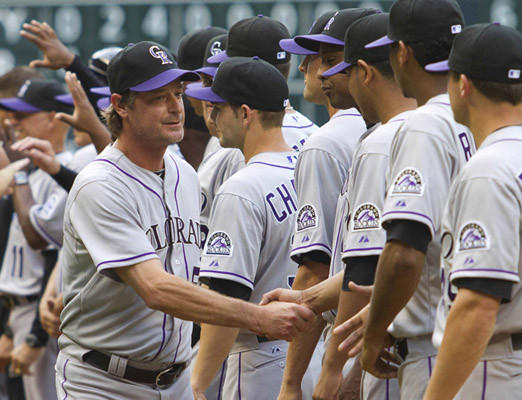 Colorado Rockies pitcher Jamie Moyer (L) greets his teammates during opening day ceremonies as the Houston Astros play against the Rockies on opening day of the MLB National League season in Houston April 6, 2012.