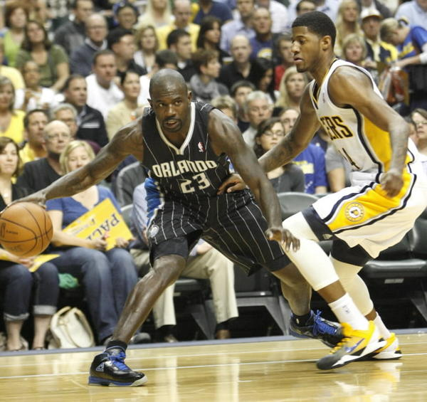 Orlando Magic guard Jason Richardson is guarded by Indiana's Paul George.