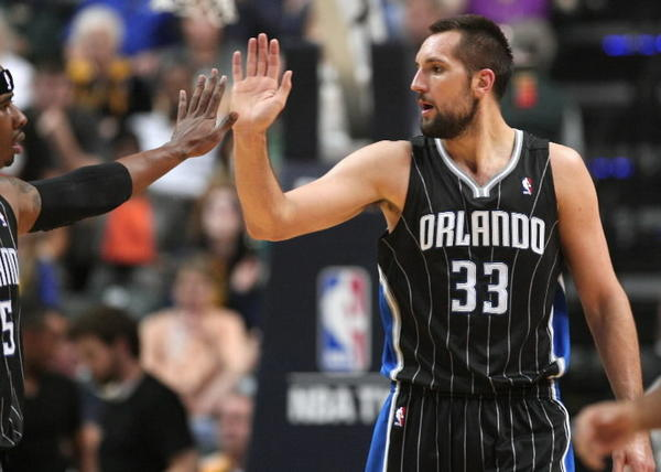 Orlando Magic players Quentin Richardson, left, and Ryan Anderson, right, exchange a high five during Game 2.
