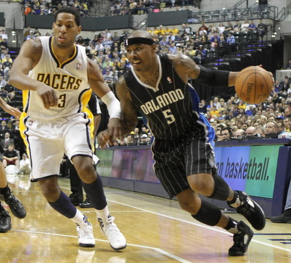 Orlando Magic forward Quentin Richardson drives past Indiana forward Danny Granger.