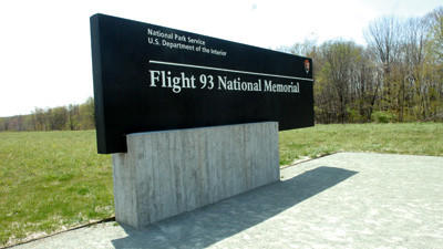 The Flight 93 National Memorial will benefit from an upcoming fundraiser that will include two former presidents. Visitors are seen there on Monday.