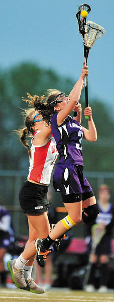 North Hagerstown's Leah Peterson, left, and Smithsburg's Dominique Dilandro battle for the ball during the Hubs' 16-10 win.