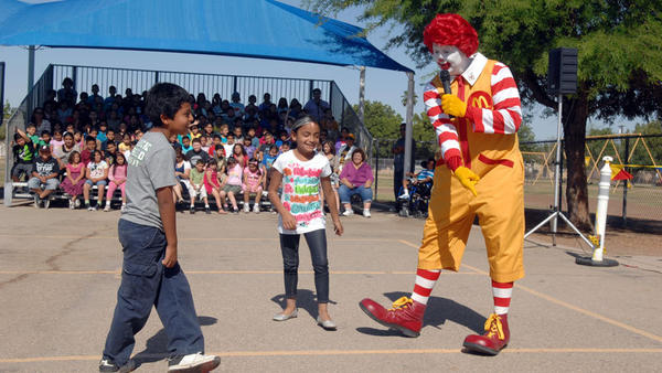 Ronald McDonald gives instructions to student participants in teaching character traits at J.W. Oakley Elementary School in Brawley on Monday. Ronald McDonald taught character traits such as trustworthiness, responsibility, respect and fairness.