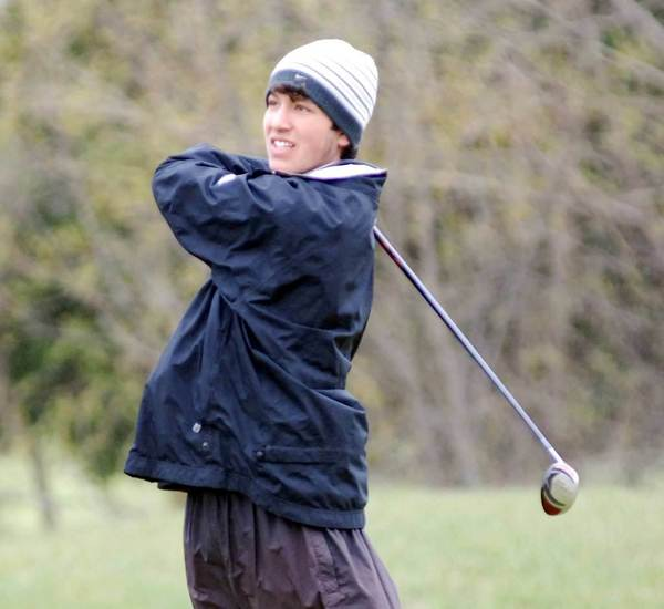 Tyler Spiegl of Petoskey follows one of his tee shots Monday during the Jim Glynn Rayder Classic at Belvedere Golf Club in Charlevoix. Spiegl helped the Northmen to a first-place finish in the 13-team event.
