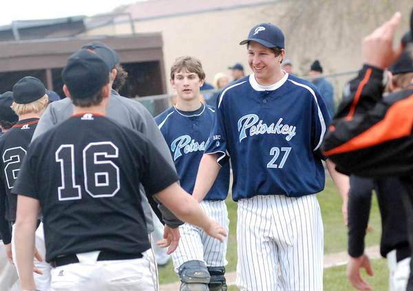 Dillon Kelley leads his Northmen teammates through the handshake line Monday after the Northmen posted a non-league sweep of Cheboygan at Turcott Field. Petoskey extended its win streak to eight games with the two wins.