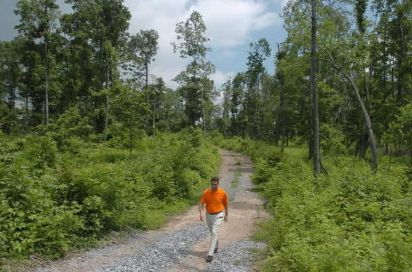 Developer Michael Carnock walks through 935-acre tract near Green Ridge State Forest where he hopes to build 4,000 homes. (2005 photo)