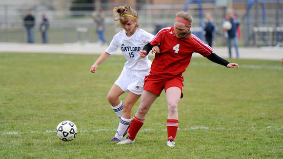 Gaylord sophomore Taylor Kaiser battles with Suttons Bay's Autumn Reyhl during the Blue Devils' 4-0 home victory Monday.