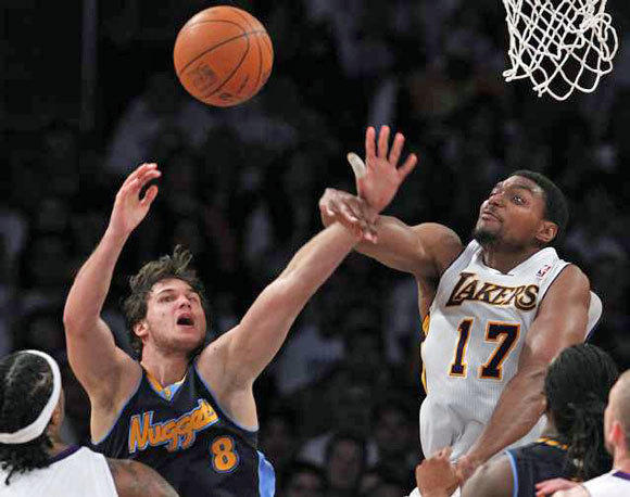 Andrew Bynum blocks the shot of Nuggets forward Danilo Gallinari in the second half of Game 1.