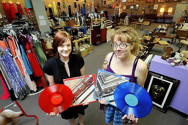 Darcia Mickey, left, and Betty Golliday hold rare LPs they sell at Unique Boutique, which they co-own in the Martinsburg (W.Va.) Mall.