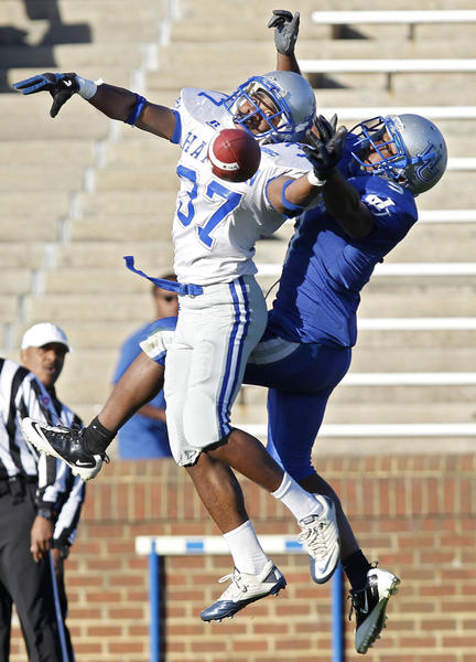 Terrance Rogers (left) breaks up a pass intended for Javaris Brown during the fourth quarter of the Hampton University spring game.