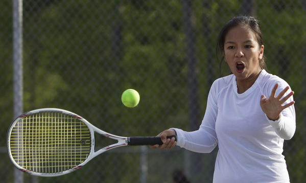 Hampton's Abi Castro returns a serve during a doubles match against Gloucester on Thursday, April 12.