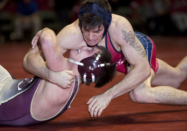 Liberty's Mark Busse gains position on Apprentice School's BJ Compton in a 165-lb. match at the Virginia Duals on Saturday, January 14.