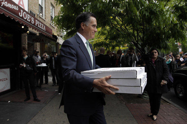 Republican presidential candidate and former Massachusetts Gov. Mitt Romney brings pizza to a firehouse in New York.