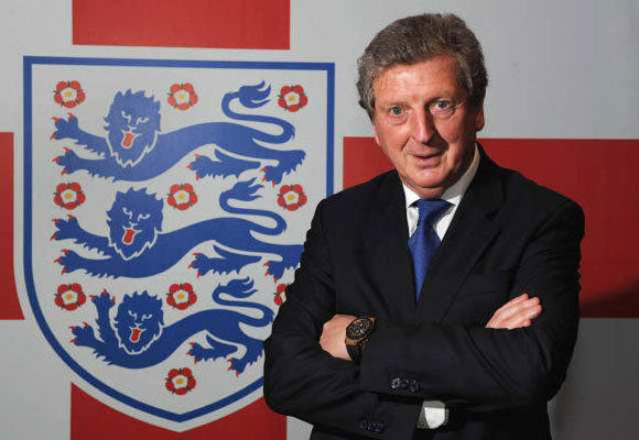 New England manager Roy Hodgson poses after a news conference at Wembley Stadium on May 1.