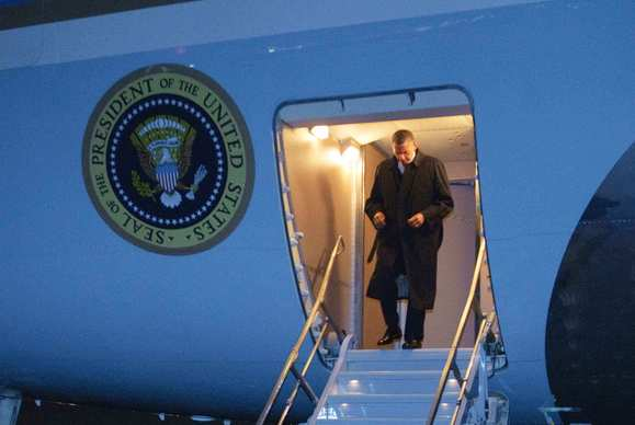 President Obama steps off Air Force One upon arrival at Bagram air base, north of Kabul, Afghanistan.