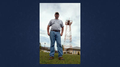 Somerset County Airport Manager Dave Wright stands in front of the airport's beacon slated for replacement.