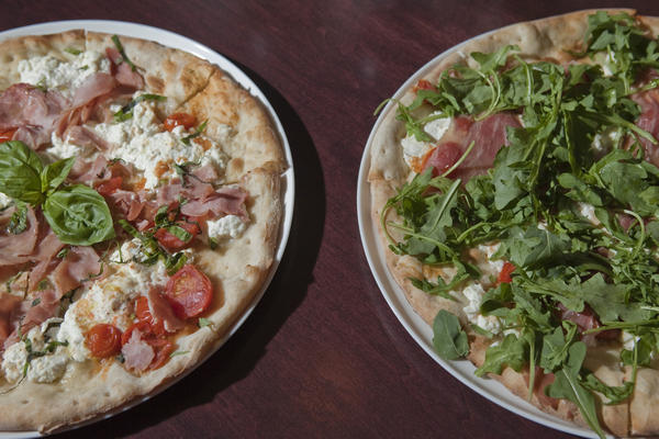 Volare's new pizzas include the namesake Volare (left) and Bianca alla Prosciutto (right).