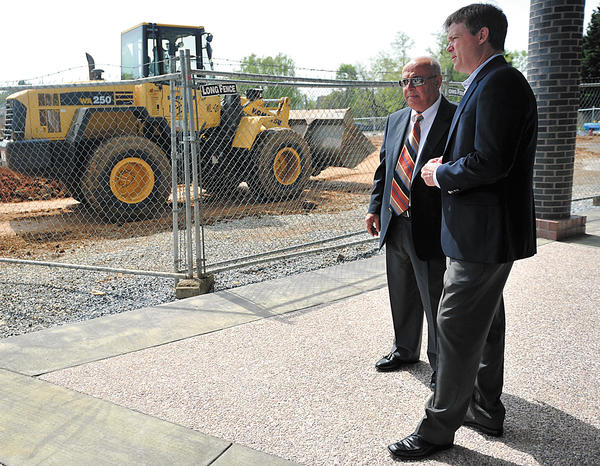 Asad Ghattas, left, owner and president of Ghattas Enterprises, talks with Greg Brown, president of Waynesboro Construction, Tuesday before a groundbreaking ceremony for the Fountainhead One office building located at Fountainhead Plaza near Hagerstown.