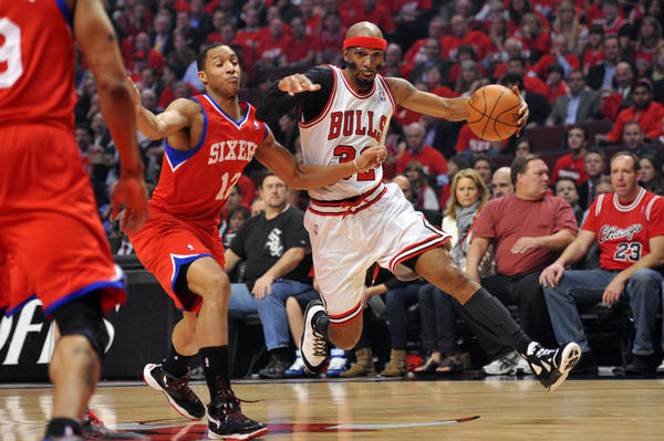 Bulls guard Richard Hamilton drives past the 76ers' Evan Turner in Game 2. (US Presswire photo)