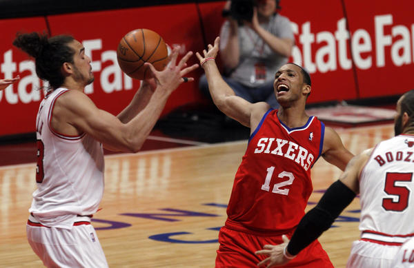 Bulls center Joakim Noah, left, steals the ball from the 76ers' Evan Turner in Game 2. (Brian Cassella/Tribune photo)