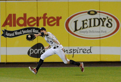 Lehigh Valley IronPigs' outfielder Rich Thompson (12) stretches out to make a catch against the Charlotte Knights at Coca-Cola Park in Allentown Tuesday night.
