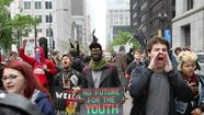 In a series of May Day rallies and marches Tuesday, police and protesters alike got a miniature glimpse of what the NATO weekend in Chicago might look like, though officials cautioned it is impossible to predict what the tone of demonstrations may be during the May summit.