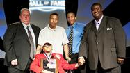 Former Fleming County Track and Field standout Maxine Graham was inducted into the Dawahares/ Kentucky High¿School Athletic Hall of Fame last weekend in Lexington. Graham is joined by KHSAA¿Commissioner Julian Tackett, sons Robelle Rogers and Charlie Rogers and brother Robbie Graham.