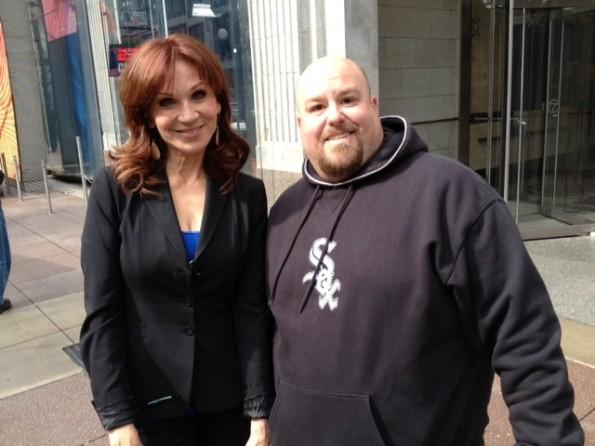 "Actress Marilu Henner poses with a fan outside of ABC Studios following her appearance on ""Windy City Live"" May 1, 2012."