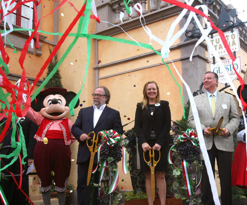 Confetti flies as VIPs cut the ribbon during the opening ceremony on the new Tutto Gusto Wine Cellar, in the Italy pavilion at Epcot, Tuesday, May 1, 2012.   From left, Mickey; chef Joachim Splichal; Epcot vice president Erin Youngs; CEO of Patina Restaurant Group Nick Valenti; and Minnie.   The wine cellar is adjacent to the Tutto Italia restaurant, which also reopened to guests, Tuesday, after renovations.