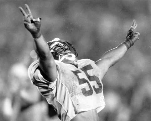 At 1990's Rose Bowl meet-up, Junior Seau, playing for USC, celebrates after sacking Michigan's quarterback.