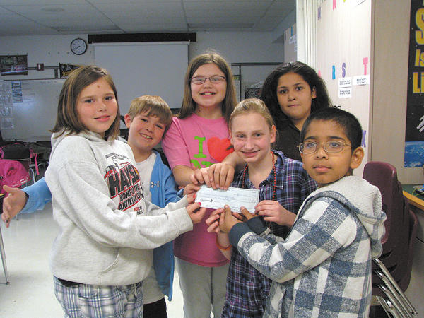 Holding a check for the Humane Society of Washington County are Lincolnshire Elementary School students, from left, Carly, Kameron, Monica, Molly, Evette and Aaryan. Not pictured: Marly.