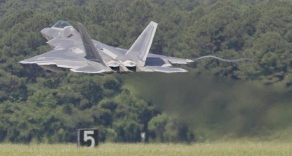 The F-22 Raptor taking off.