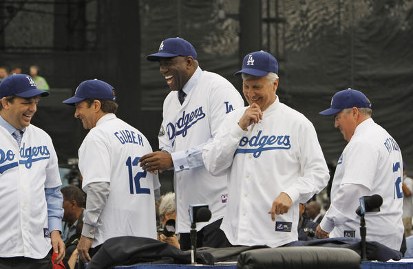 The Dodgers new ownership group shares a laugh after being introduced to the media, They are from left; Todd Boehly, Peter Guber, Earvin ' Magic' Johnson, Mark R. Walter and Bobby Patton.