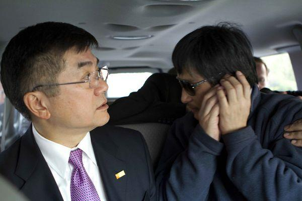 Chinese dissident Chen Guangcheng, right, with U.S. Ambassador Gary Locke, leaves Wednesday for a Beijing hospital after spending nearly a week at the U.S. Embassy.