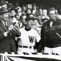 1957: Eisenhower throws first pitch