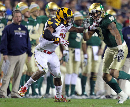 Maryland cornerback Trenton Hughes defends Notre Dame wide receiver Michael Floyd.