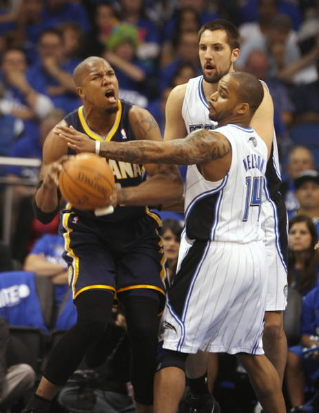 Pacers forward David West tries to get around Orlando's Jameer Nelson.