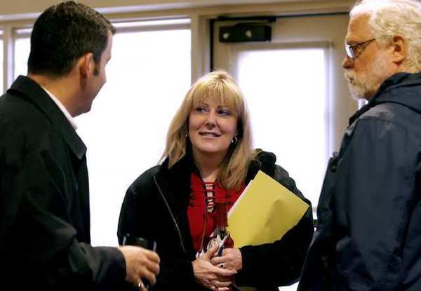 Outgoing President/Supt. Dawn Lindsay talks with Glendale Community College Board of Trustees member Tony Tartaglia, left, and political science professor John Queen after a meeting at the college.