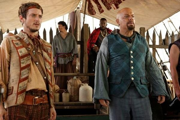 "Elijah Wood (as Ben Gunn) and Eddie Izzard (as Long John Silver) star in Syfy's ""Treasure Island."""