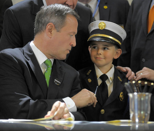 Gov. Martin O'Malley hands his pen he used to Colton Miller, 7 of Cecilton, who is the Little Fire Chief for the Kennedyville VFC in Kent County and the Deputy Little Fire Chief for the Maryland Fire Chiefs Association. O'Malley had just signed two fire-safety bills Wednesday at the State House.