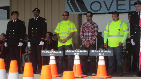 FROM LEFT: Stephen Palmer Jr. stands next to Jaime Obeso Jr. and Ron Gonzalez during a solemn ceremony that honored their fathers Wednesday at the California Department of Transportation work yard in Brawley. The ceremony paid tribute to Caltrans workers who lost their lives while on duty.