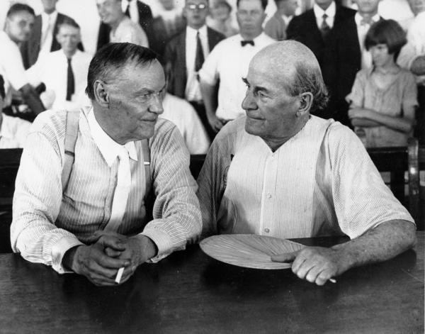"In 1925, when Tennessee high school teacher John Scopes was arrested on a charge of teaching his students about evolution, The Sun's reporting (and legal aid) made the case a national cause celebre. Covering the hearing, H.L. Mencken coined the terms ""Monkey Trial"" and ""Bible Belt,"" and derided prosecutor William Jennings Bryan (right, with defense attorney Clarence Darrow).<br><br>
