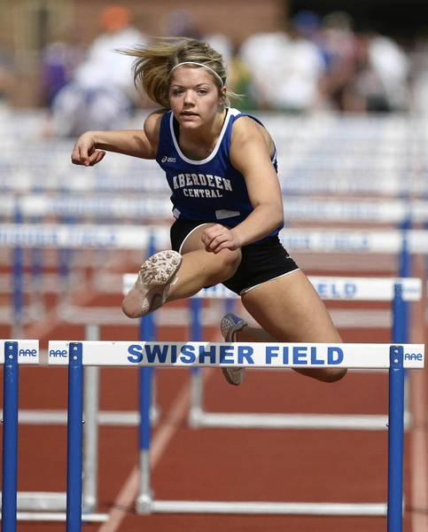 Aberdeen Central's Jenny Janish competes in the girls 100 meter hurdles at the Al Sahli Invitational track meet Saturday at Swisher Field. photo by john davis taken 3/31/2012