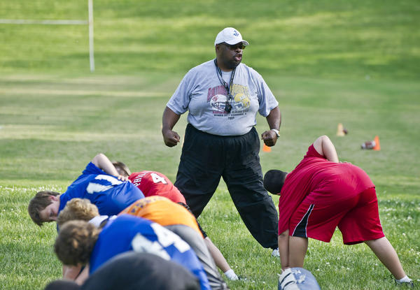 Danville assistant coach Vaughn Little¿s booming voice packs a big punch during football season, but Danville players say Vaughn is taking a ¿softer tone¿ this week at the Danville Youth Football Camp.
