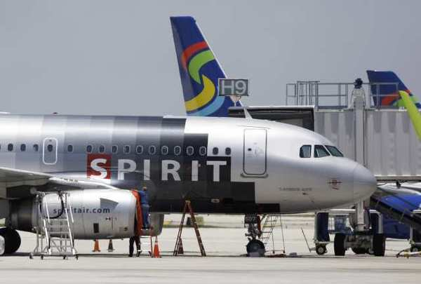 A Spirit Airlines plane sits on the tarmac.